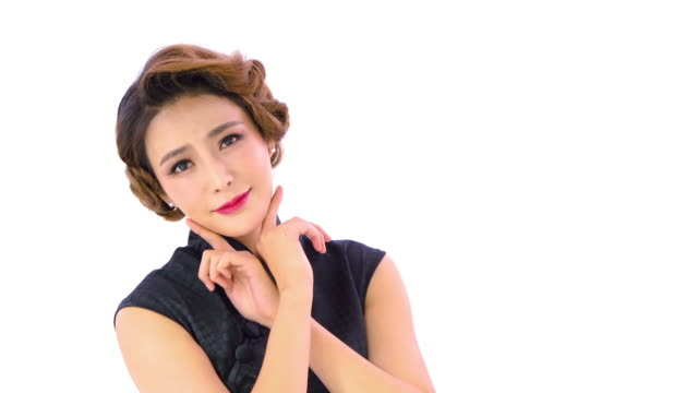 ms chinese woman in cheongsam posing against white background - einzelne frau über 30 stock-videos und b-roll-filmmaterial
