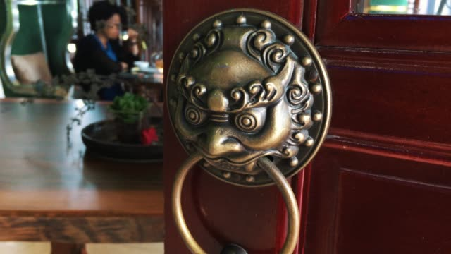 chinese wood door with lion knocker - door knocker stock videos & royalty-free footage