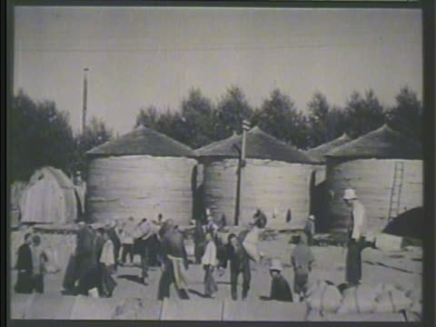 chinese workers carrying sacks of grain, silos bg. vs chinese workers dropping stacks onto conveyor outdoors. japanese occupation, japan occupied,... - manchuria stock videos & royalty-free footage