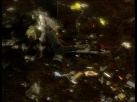 mull of kintyre airv helicopter wreckage zoom in frame belongings scattered on ground airv chared hillside around crash site pull out airv more ditto... - ヘリコプター事故点の映像素材/bロール