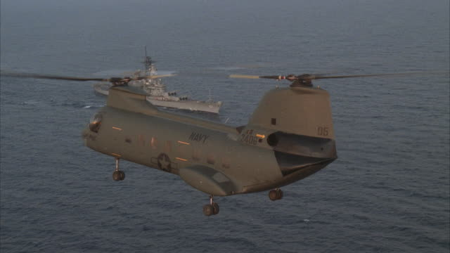 air to air, ch-47 chinook flying over uss missouri on sea at sunset - military helicopter stock videos and b-roll footage