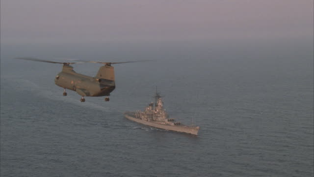 air to air, ch-47 chinook flying over uss missouri on sea - uss missouri stock videos and b-roll footage