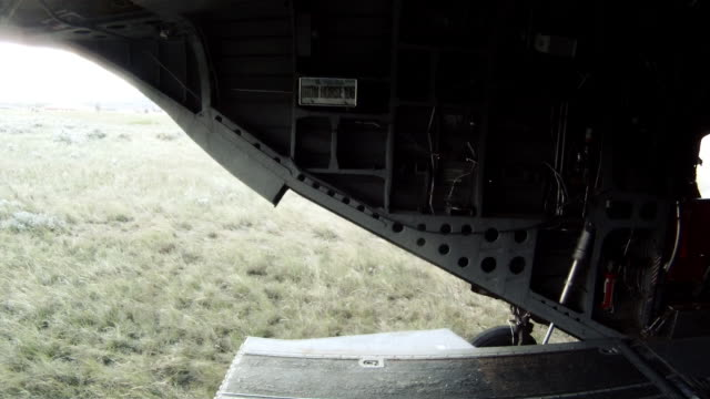 ch-47 chinook helicopter as it lands, the ramp lowers, and soldiers move out. - us air force stock videos & royalty-free footage