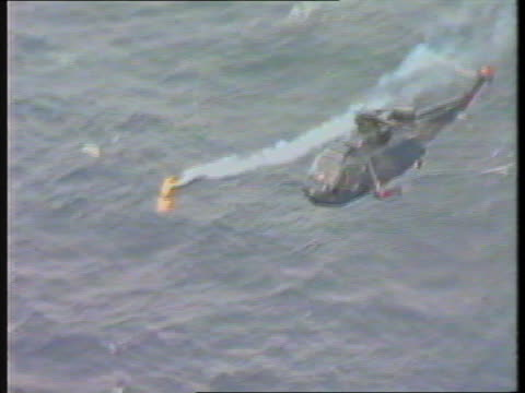 chinook helicopter crash government report off airv rescue workers holding section of tx shetland helicopter winched up from sea itn - ヘリコプター事故点の映像素材/bロール