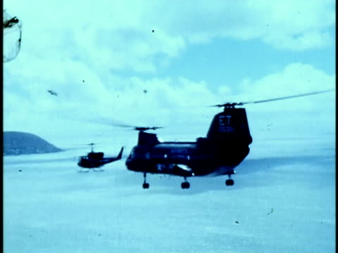 1975 ws ha pov ch-47 chinook helicopter flying over coastline from kaneohe marine corps military base/ oahu, hawaii islands, usa - western script stock videos & royalty-free footage