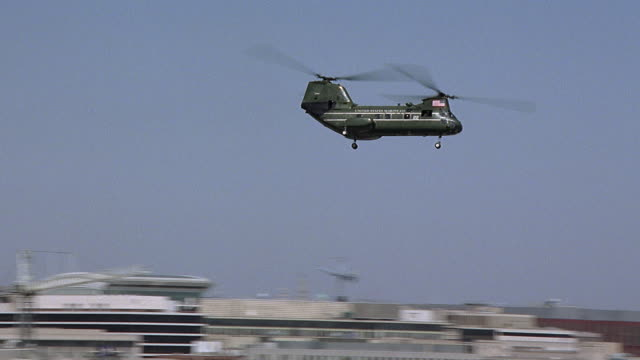 aerial ws pan chinook helicopter flying past capitol building and washington monument / washington dc, usa - military helicopter stock videos & royalty-free footage