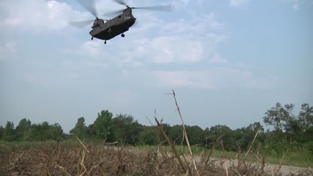 chinook helicopter from bravo company 7th battalion 158th aviation regiment from new century ks lifts a bridging section and will fly it to drop in... - battalion stock videos and b-roll footage