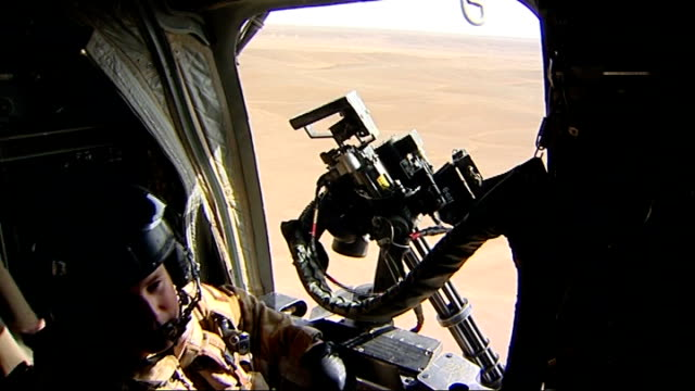 chinook helicopter interiors; mid air / int helicopter bv pilots in chinook cockpit as in flight face of pilot reflected in rear view mirror, as he... - skibrille stock-videos und b-roll-filmmaterial
