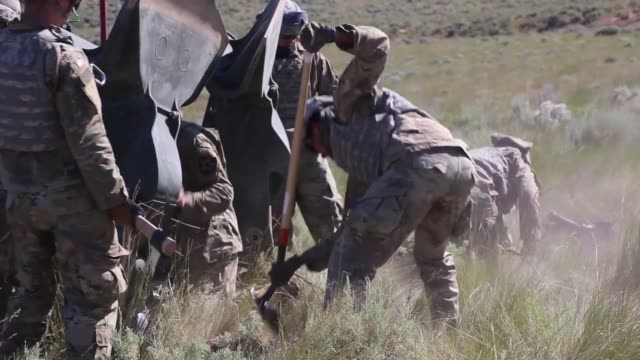 chinooks deliver m777 howitzers by sling load for soldiers with washington army national guard to conduct an artillery raid at yakima training... - howitzer stock videos & royalty-free footage