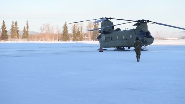 Chinooks from 1st Battalion 52nd Aviation Regiment carrying Marines from 2nd Battalion 8th Field Artillery Regiment conduct ground refueling...