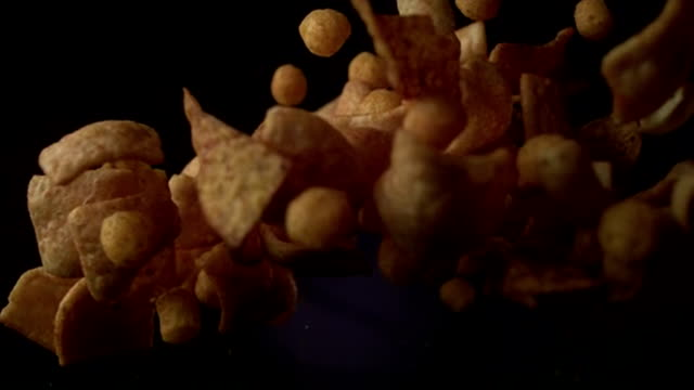 chips mix jumping in slow motion. - food styling stock videos & royalty-free footage