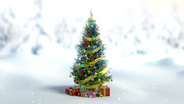 chiristmas tree with giftboxes under sonowing 4k-zoom in - christmas tree stock videos & royalty-free footage