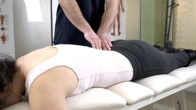 chiropractic massage - chiropractic adjustment stock videos & royalty-free footage