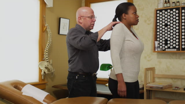 ms chiropractor treating female patient / manchester, vermont, usa - waist stock videos & royalty-free footage