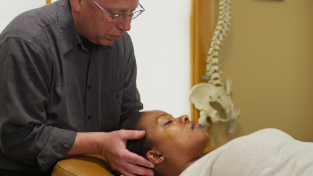 MS TD Chiropractor treating female patient / Manchester, Vermont, USA
