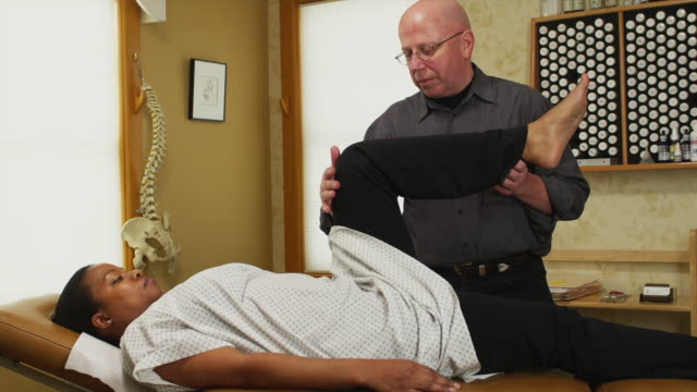 ms chiropractor treating female patient / manchester, vermont, usa - osteopath stock videos & royalty-free footage