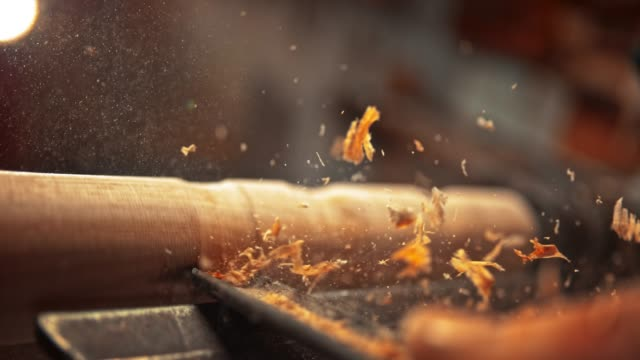 slo mo chisel being used to decorate a piece of wood and particles are flying in the air - non us film location stock videos & royalty-free footage