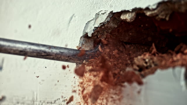 slo mo ld chisel drilling into the wall to break it down - demolishing stock videos & royalty-free footage
