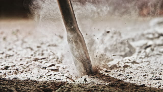 slo mo chisel of a jackhammer penetrating concrete - concrete stock videos & royalty-free footage