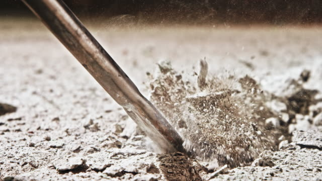 slo mo chisel of a pneumatic hammer penetrating through concrete - pneumatic drill stock videos & royalty-free footage