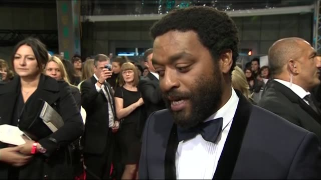 chiwetel ejiofor speaks about his relationship and experience with bafta during red carpet interview at the baftas 2014 - 2014 stock videos & royalty-free footage