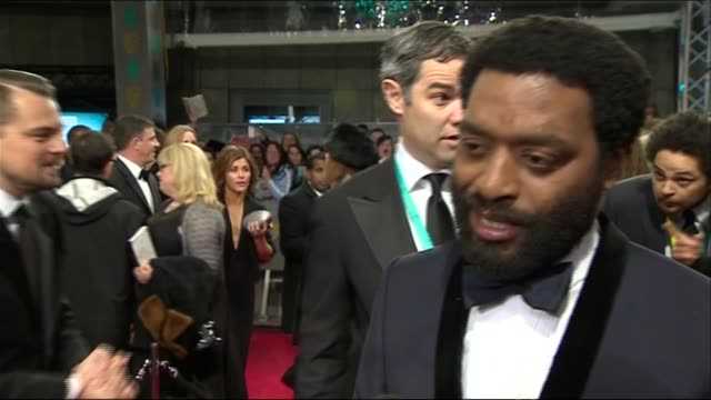 chiwetel ejiofor speaks about the opportunity to work with steve mcqueen during red carpet interview at the baftas 2014 - 2014 stock videos & royalty-free footage