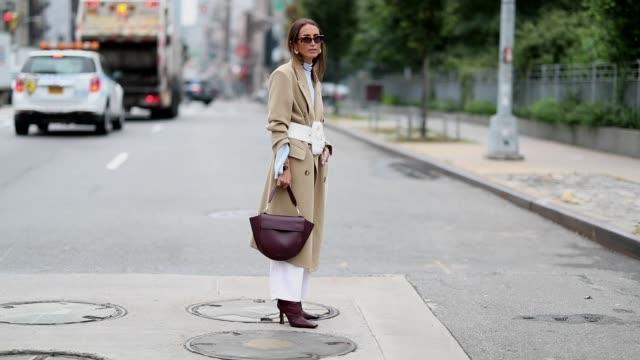 chloe harrouche wearing wangler bag beige wool coat is seen outside oscar de la renta during new york fashion week spring/summer 2019 on september 11... - new york fashion week stock videos & royalty-free footage