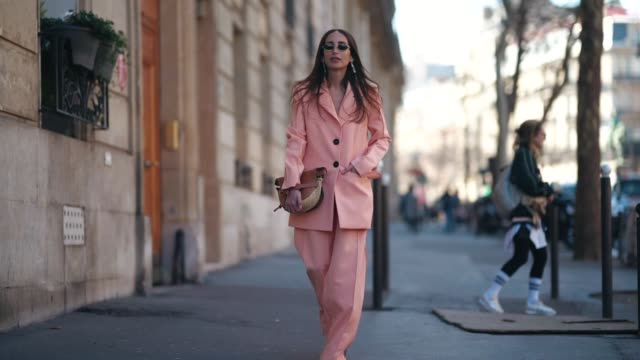 Chloe Harrouche wears sunglasses a pink blazer jacket a Loewe bag flare pants outside Dries Van Noten during Paris Fashion Week Womenswear...