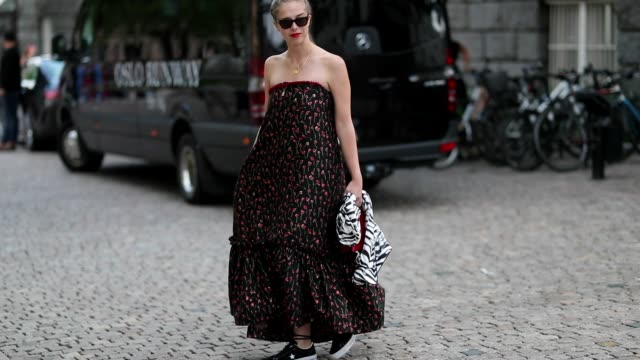 Chloe King wearing off shoulder dress is seen outside the 'Line of Oslo' show during Oslo Runway SS19 on August 15 2018 in Oslo Norway