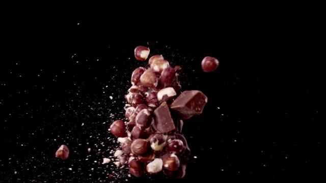 chocolate and hazelnuts colliding in the air super slow motion video 1000 fps - hazelnut stock videos & royalty-free footage