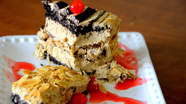 chocolate and nuts mousse cake garnished with red cherry - red delicious stock videos & royalty-free footage