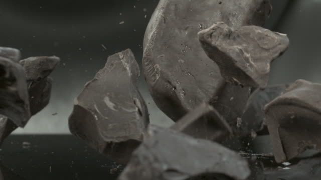 chocolate blocks falling onto hard surface - solid stock videos & royalty-free footage