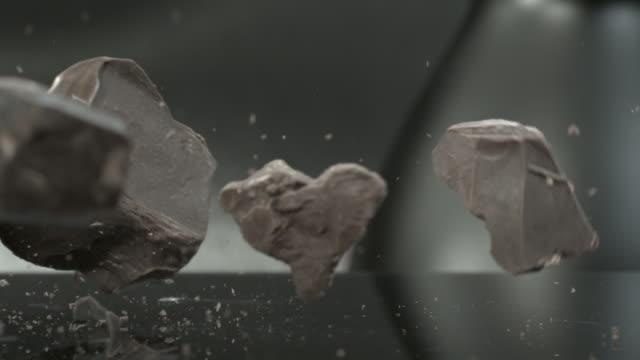 chocolate blocks falling onto hard surface - chocolate stock videos & royalty-free footage