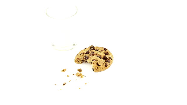 chocolate chip cookie with milk - chocolate chip cookie stock videos and b-roll footage
