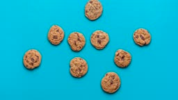 Chocolate chip cookies animation. Cookies moving on blue background