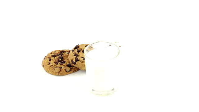 chocolate chip cookies with milk - crumb stock videos and b-roll footage
