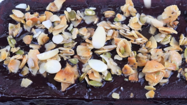 chocolate cover and garnish of a ketogenic cake - garnish stock videos & royalty-free footage