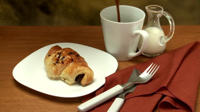 chocolate croissant & coffee pour breakfast - french bakery stock videos & royalty-free footage