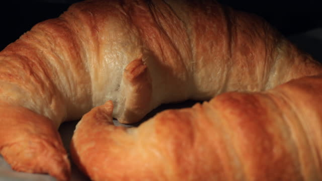 chocolate croissant in the oven... 4k - puff pastry stock videos & royalty-free footage