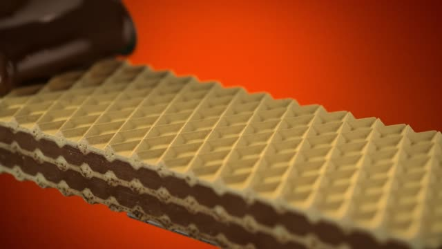 chocolate folding on wafer - wafer stock videos and b-roll footage
