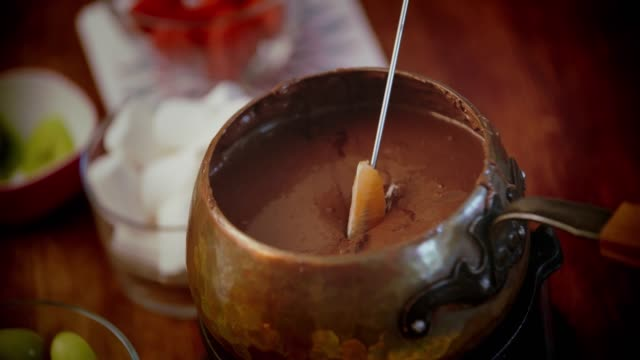 chocolate fondue in a pot served with fruits - fondue stock videos & royalty-free footage
