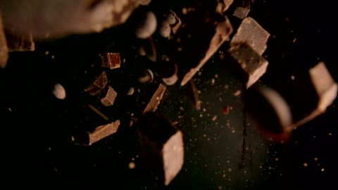 chocolate food explosion with chocolate chips - chocolate stock videos & royalty-free footage