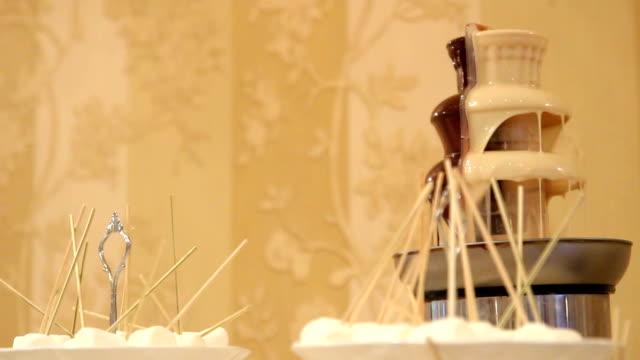 chocolate fountain - fondue stock videos & royalty-free footage