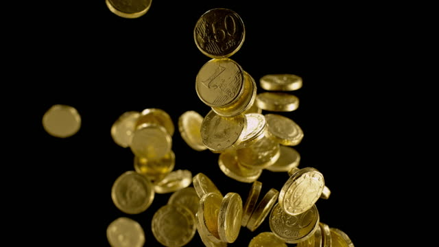 slo mo ld chocolate gold coin candy flying in the air - coin stock videos & royalty-free footage