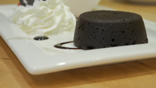chocolate lava with panning movement , 4k(uhd) - icing stock videos and b-roll footage