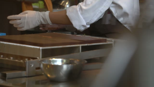 chocolate making - chocolate factory stock videos & royalty-free footage