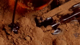 Chocolate pouring, dripping Into cacao slow motion. Shot on RED EPIC Cinema Camera.