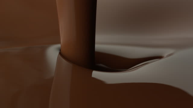 vídeos de stock, filmes e b-roll de chocolate pours into a pool of chocolate. - chocolate