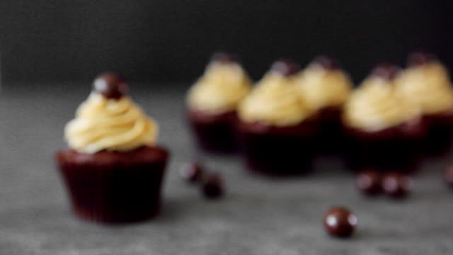 chocolate spread cupcakes on the table - indulgence stock videos & royalty-free footage