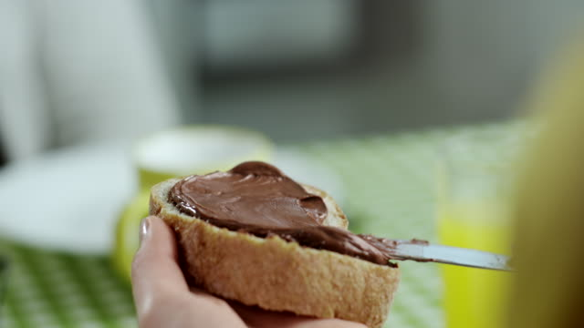chocolate spread - bread stock videos & royalty-free footage